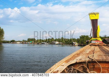 Longtail Boat On The River Near The City Of Krabi, Thailand