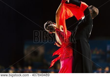 Dancers Man In Black Tailcoat And Woman In Red Ball Gown