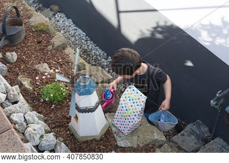 Heiligenhaus, Nrw, Germany - April 21, 2019:\nlittle Boy Is Looking For Colorful Easter Eggs In The