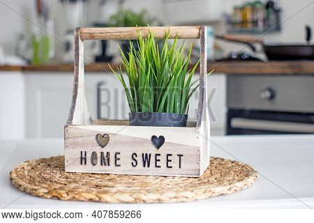 Authentic Kitchen Table With A Bunch Of Herbs In Wooden Stand With The Inscription Home Sweet Home,