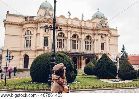Tourist Admiring Krakow Slowackiego Theater Exterior In Poland. Architecture, Landmarks Of Krakow Ol