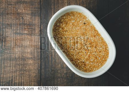 Sweet Dipping Sauce With Ground Peanut In White Bowl, Thai Style Dipping Sauce