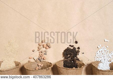 Several Peat Pots With Different Ingredients For Preparing Fertile Soil For Plants, Stones For Drain