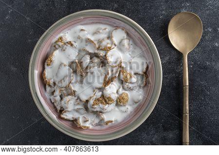 Whole Grain Glazed Flakes With Yogurt In Plate. Healthy Breakfast, Whole Grain Muesli In A Bowl