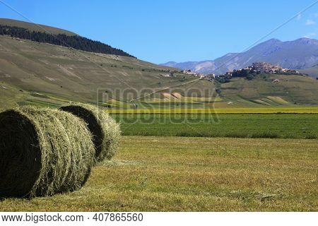 Norcia (pg), Italy - May 25, 2015: Bale Of Hay Near Castelluccio Di Norcia, Highland Of Castelluccio