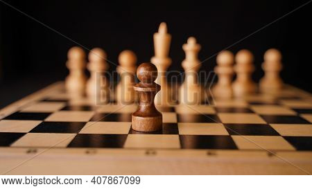 Close Up Of White And Black Wooden Chess Pieces On Board. Selective Focus On Confrontation Of Black