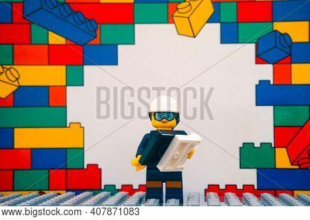 Tambov, Russian Federation - January 17, 2021 Lego Engineer Minifigure With Blueprint Standing Again
