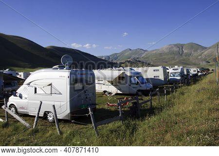 Norcia (pg), Italy - May 25, 2015: Campers Near Castelluccio Di Norcia, Highland Of Castelluccio Di