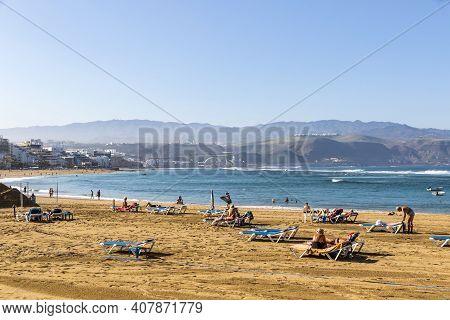 Las Palmas, Spain - December 2018: People Relax At Las Canteras Beach (playa De Las Canteras) In Las