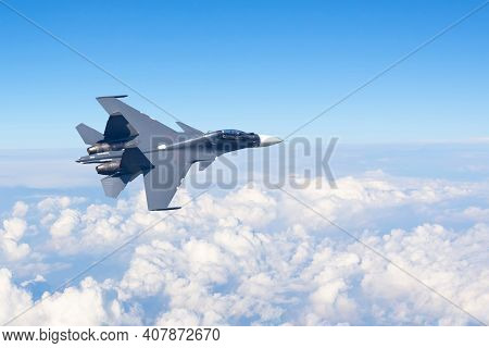 Combat Fighter Jet Flies Turning Maneuver High In The Sky Above The Clouds