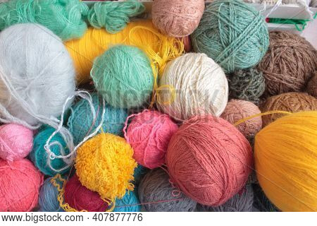 A Large Number Of Multi-colored Balls Of Threads Of Different Sizes In A Box. Background From Colorf