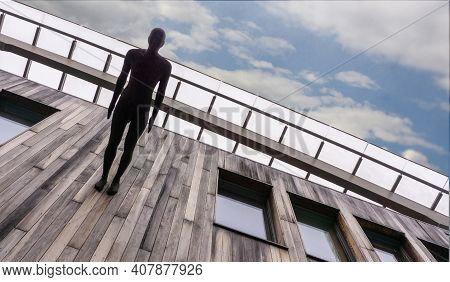 Oslo, Norway - December, 2020. The Male Figure Is Attached Perpendicular To The Wooden Wall. Bottom