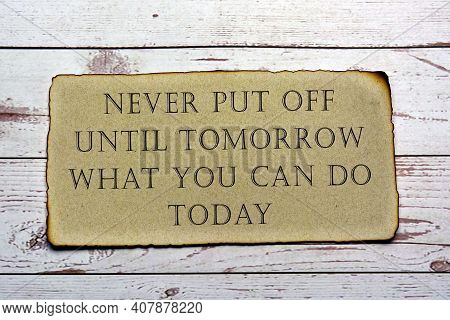 Motivational And Inspirational Quote On Paper With Burnt Edge - Never Put Off Until Tomorrow What Yo