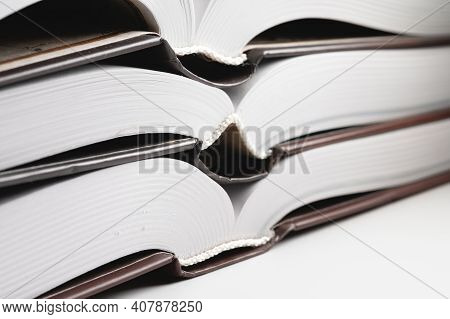 Binding Of A New Book. Close-up Of A Layer Of Pages. Library Background