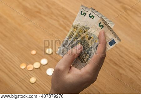 Close Up Of A Man Hand Holding Money Banknotes
