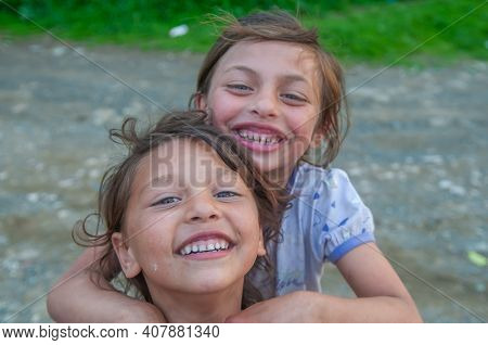 5-16-2018. Lomnicka, Slovakia. A Close-up Of Two Roma Or Gypsy Girls In An Abandoned Community In Th
