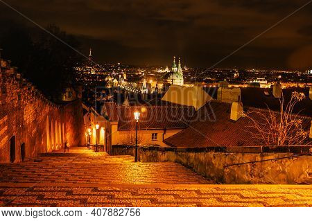 Evening Walk In Empty City Of Prague,czech Republic.illuminated Old Stairs From Prague Castle To Les