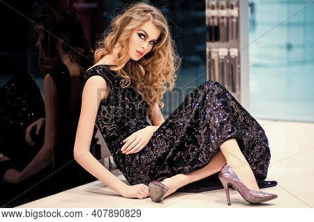 Fashion Girl In Evening Dress Sit On Floor. Vogue Style. Beauty Look. Fashion Photo Of Beautiful Wom