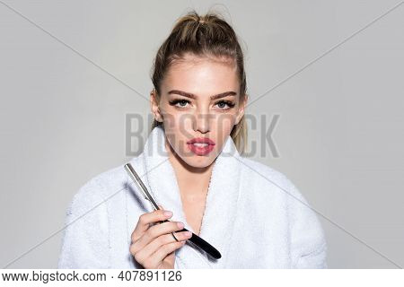 Woman With Attractive Lips Holds Straight Razor In Hand. Barbershop Concept. Lady Play With Sharp Bl