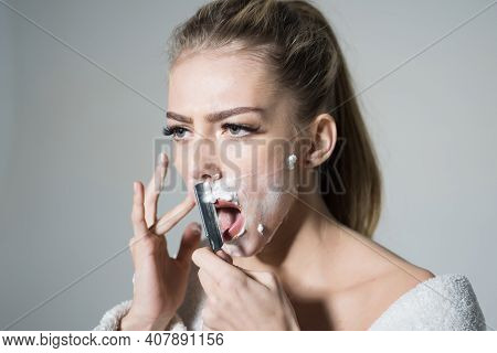 Girl Moustache. Barber And Shaving Concept. Woman With Face Covered With Foam Holds Straight Razor I