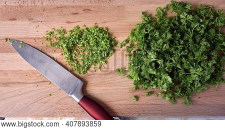 Parsley. Greens On A Cutting Board. Finely Chopped Parsley For Salad.
