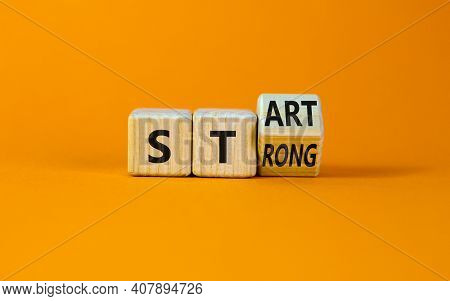 Start Strong Symbol. Turned Wooden Cubes With Words 'start Strong'. Beautiful Orange Background, Cop