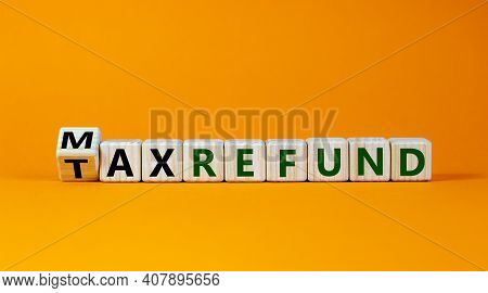 Max Tax Refund Symbol. Turned Wooden Cubes With Words 'max Tax Refund'. Beautiful Orange Background,