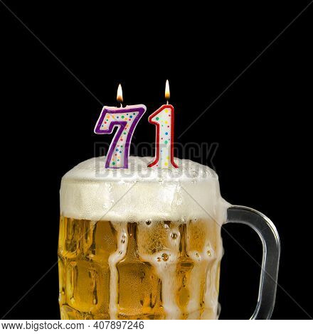 Number 71 Candle In Beer Mug For Birthday Celebration Isolated On Black