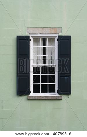 Old colonial window with shutters