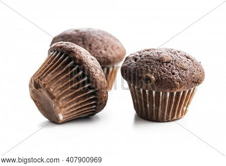 Chocolate muffins. Sweet dark cupcakes isolated on white background.
