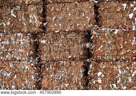 Large Blocks Of Waste Paper Cutting. Recycling Of Shredded Wastepaper Reduces The Need For Deforesta