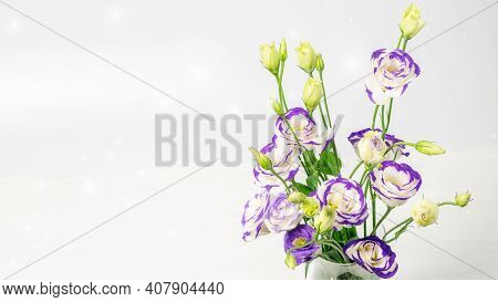 Blue And White Lisianthus Bouquet On The Blurred Background Closeup. Nice Greeting Card For Mother's