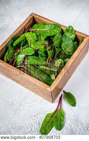 Raw Fresh Green Chard Mangold Leaves In A Wooden Box. White Background. Top View