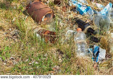 Garbage In Forest. People Illegally Throw Garbage Into Forest. Illegal Garbage Dump In Nature. Dirty