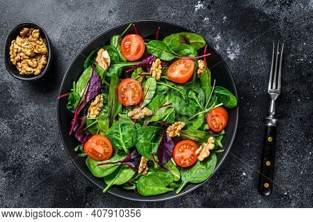 Vegetarian Salad With Mix Leaves Mangold, Swiss Chard, Spinach, Arugula And Nuts In A Salad Bowl. Bl