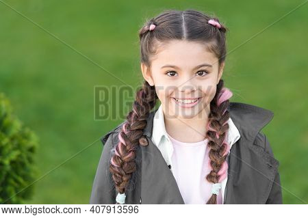 Girl Small Kid With Fashionable Braids Hairstyle. Fashion Trend. Salon And Hair Care. Girl Cute Smil