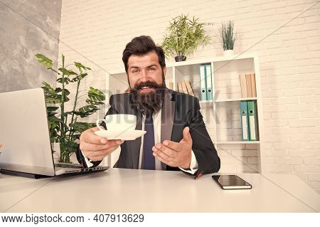 You Need Some Caffeine. Happy Hipster Serve Coffee In Office. Director Hold Hot Cup At Desk. Caffein