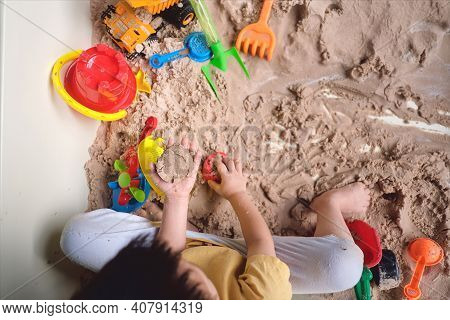 Top View, Bird Eye View Of Toddler Boy Playing With Sand Alone At Home, Fine Motor Skills Developmen