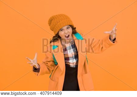 Rrrrr. Little Schoolchild Roar Frightfully. Angry Little Kid On Yellow Background. Unhappy Little Gi