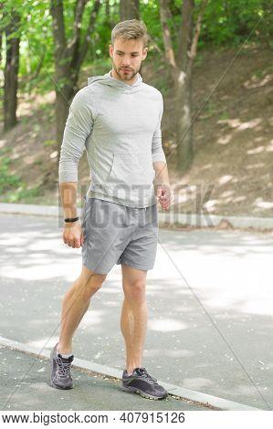 Fastest Way To Get In Shape. Sportsman Walk On Sidewalk. Strong Sportsman Wear Fitness Uniform. Spor