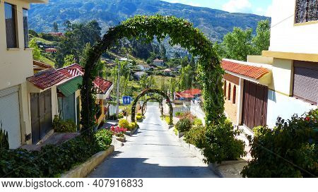 Chordeleg, Azuay, Ecuador - October 30, 2018: View At The Street With Greenery Arches Going Down To