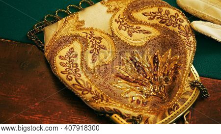 Close Up Of Vintage Purse On Wooden Table With Green Fabric. Stock Footage. Close Up Of Female Old F
