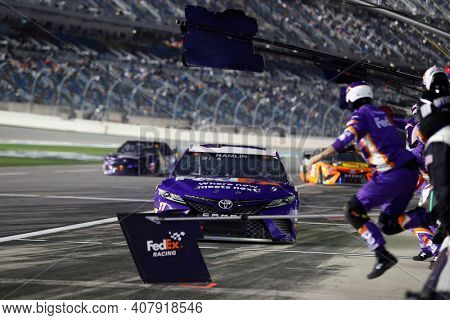 February 11, 2021 - Daytona Beach, Florida, USA: Denny Hamlin (11) pits during for the Bluegreen Vacations Duel 1 at DAYTONA at Daytona International Speedway in Daytona Beach, Florida.