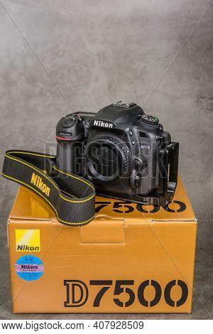 Daejeon, South Korea; Feb. 5, 2021: Nikon D7500 Dslr Camera With Selens Tripod Mount On Gold Colored