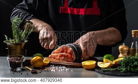Fresh Salmon With Dill. Chef Cuts With Knife The Salmon. Salmon Steak Raw Fish And Ingredients Prepa