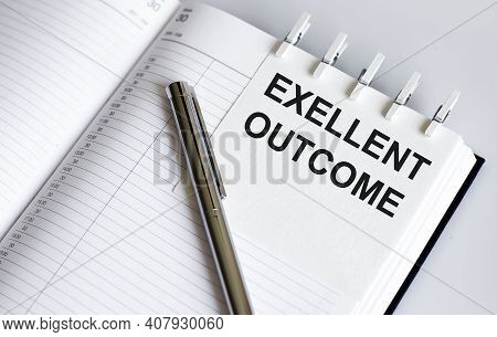 Text Exellent Outcome On Short Note Texture Background With Pen