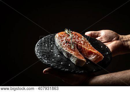 Chef Hands Prepares Fresh Salmon Steak Fish. Marinated Salmon. Salmon Steak Raw Fish And Ingredients