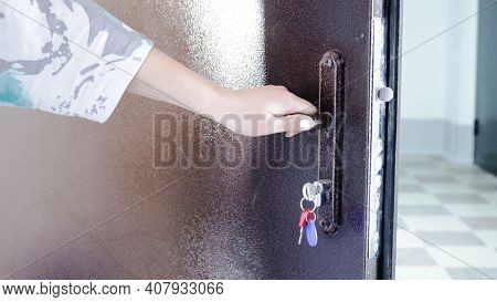 A Woman's Hand Opening The Entrance Metal Door To The Entrance Of The House From The Inside, Persona