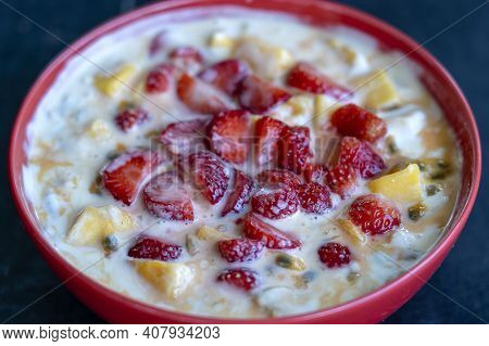 Mango, Passion Fruit, Red Strawberry And Yogurt Brulee. Fruit Dessert On Breakfast With Wedges Of Pe