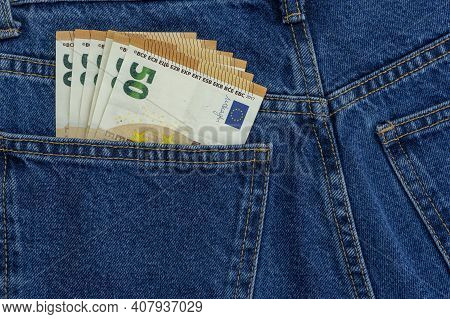 European Money Euro In Jeans Pocket Background. Cash, Money Is In The Pocket Of Blue Jeans. Close-up